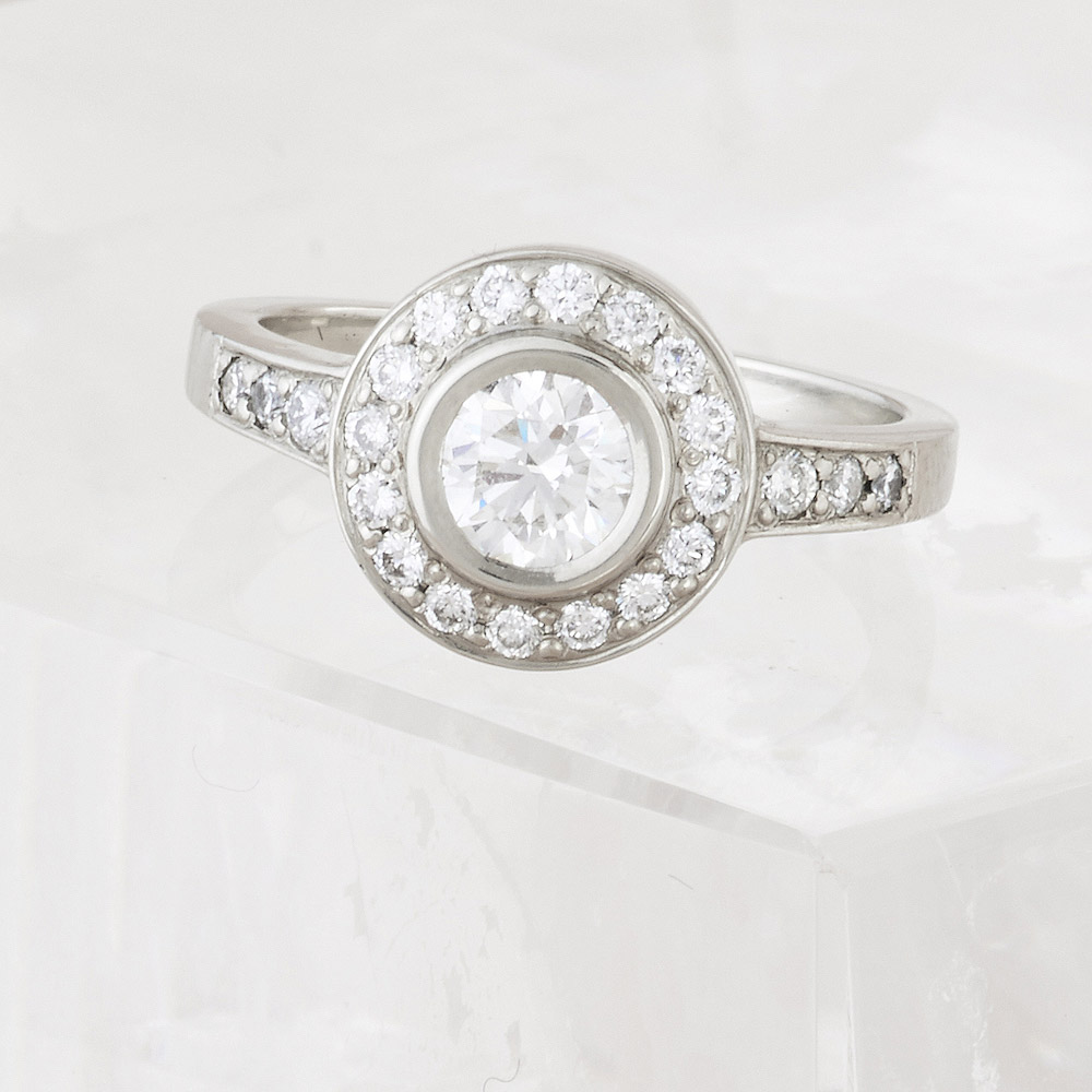 Diamond Ring with Diamond Halo center stone .55ct, accent stones .72ct tw , handmade in 18k Gold